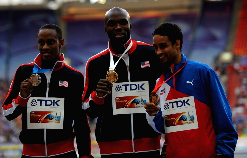 Silver medallist Tony McQuay of the U.S., his compatriot gold medallist LaShawn Merritt and bronze medallist Luguelin Santos of Dominican Republic (L-R) pose ..