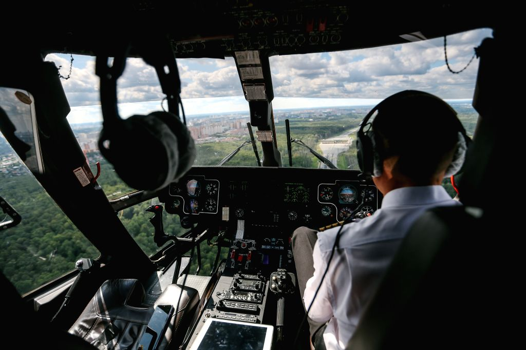 MOSCOW, Aug. 26, 2019 - A pilot flies the helicopter taxi in Moscow, Russia, on Aug. 26, 2019. The helicopter taxi will take passengers from helipark Podushkino to Zhukovsky where the international ...