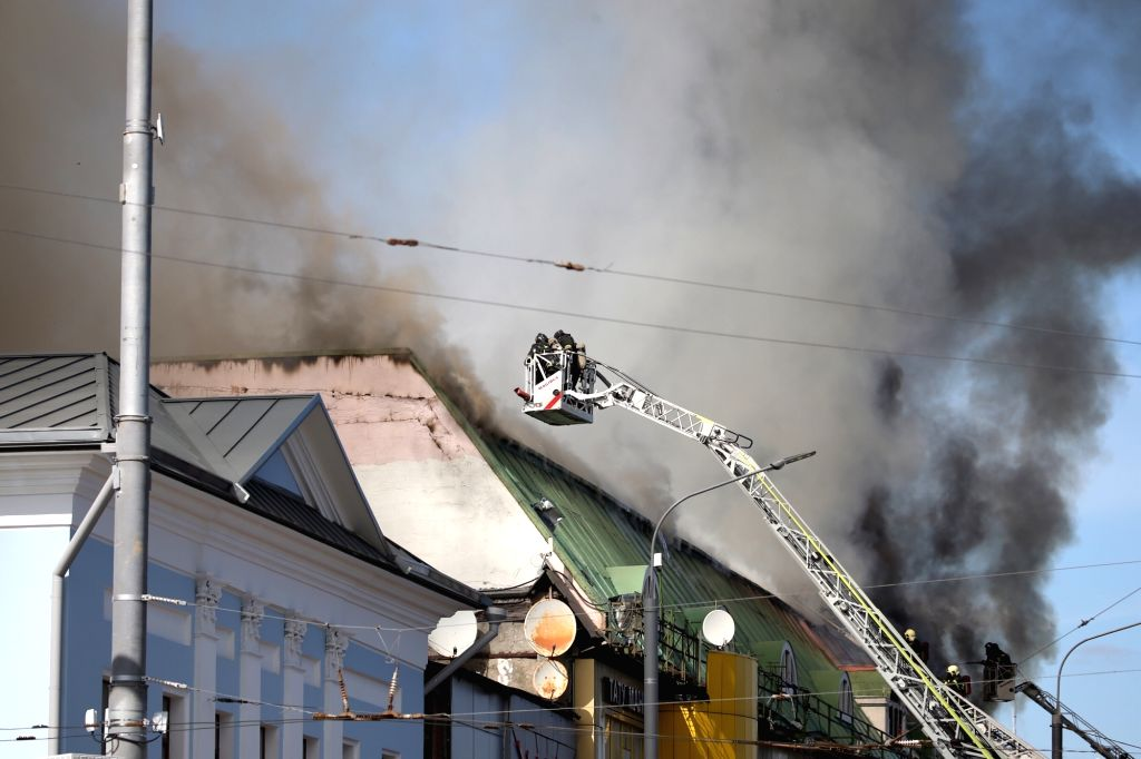 MOSCOW, Aug. 9, 2017 - Firefighters work to extinguish the fire in Moscow, Russia on Aug. 9, 2017. Fire broke out in a building in eastern Moscow, the capital of Russia, on Wednesday afternoon, ...
