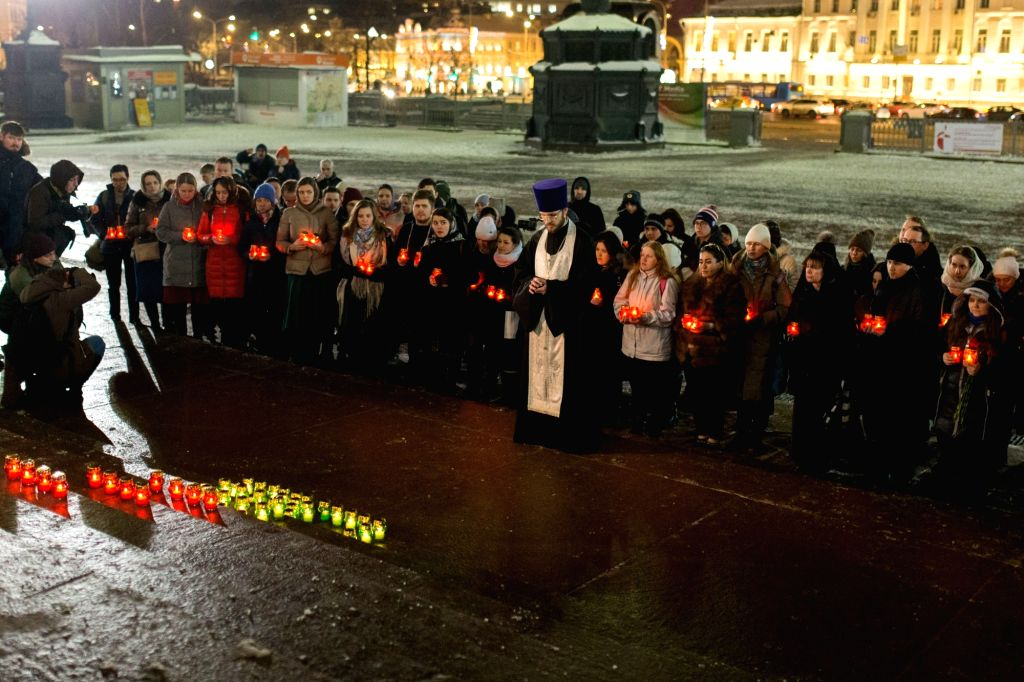 MOSCOW, Feb. 12, 2018 - People attend a memorial service to mourn the victims in the AN-148 passenger jet crash near the Cathedral of Christ the Saviour in Moscow, Russia, on Feb. 12, 2018. Rescuers ...