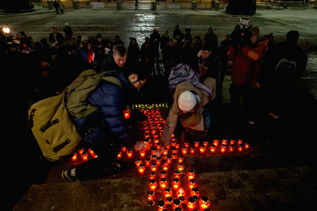 MOSCOW, Feb. 12, 2018 - People place candles to mourn the victims in the AN-148 passenger jet crash near the Cathedral of Christ the Saviour in Moscow, Russia, on Feb. 12, 2018. Rescuers have ...