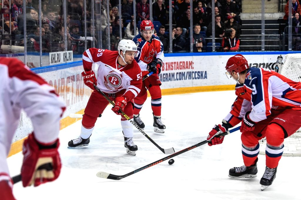 MOSCOW, Feb. 19, 2019 - Yegor Voronkov of Vityaz (L) vies with Anton Slepyshev of CSKA (1st R) during the 2018-2019 KHL game between CSKA Moscow and Vityaz Podolsk in Moscow, Russia on Feb. 18, 2019. ...