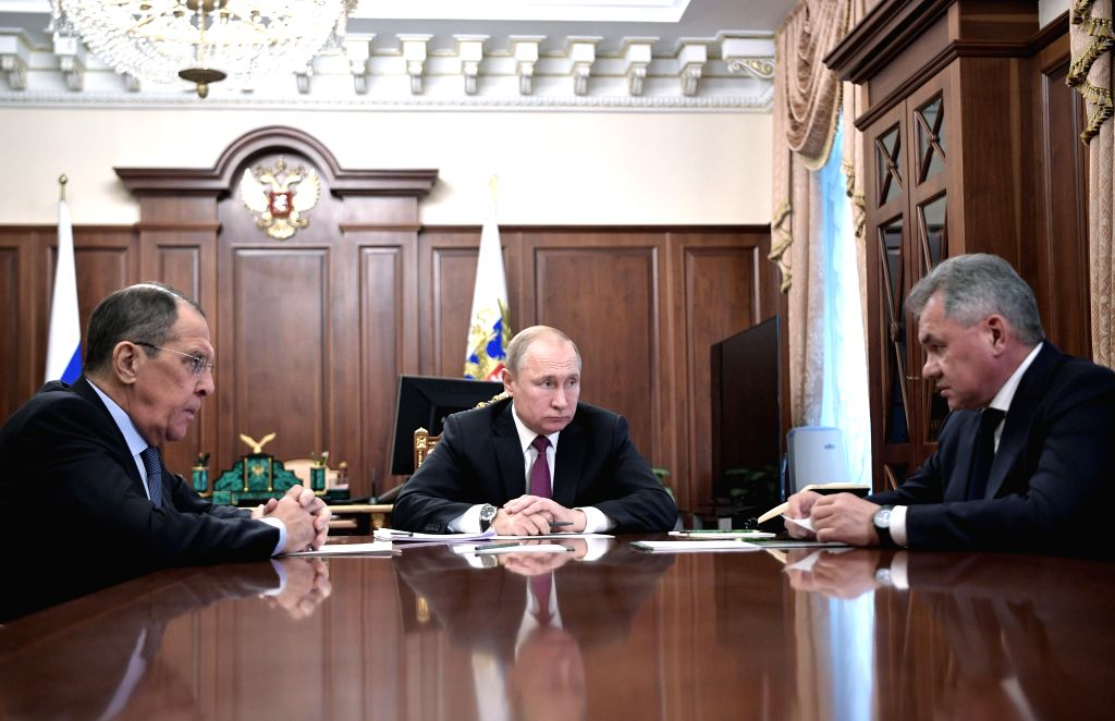 MOSCOW, Feb. 2, 2019 - Russian President Vladimir Putin (C) meets with Defence Minister Sergei Shoigu (R) and Foreign Minister Sergei Lavrov in Moscow, Russia, on Feb. 2, 2019. Russian President ... - Sergei Shoigu