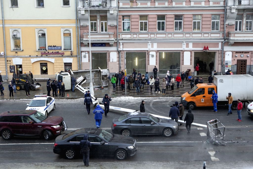 MOSCOW, Feb. 21, 2019 - A fallen crane is seen on a street in central Moscow, Russia, on Feb. 21, 2019. Two vehicles were damaged by the fallen crane here on Thursday.