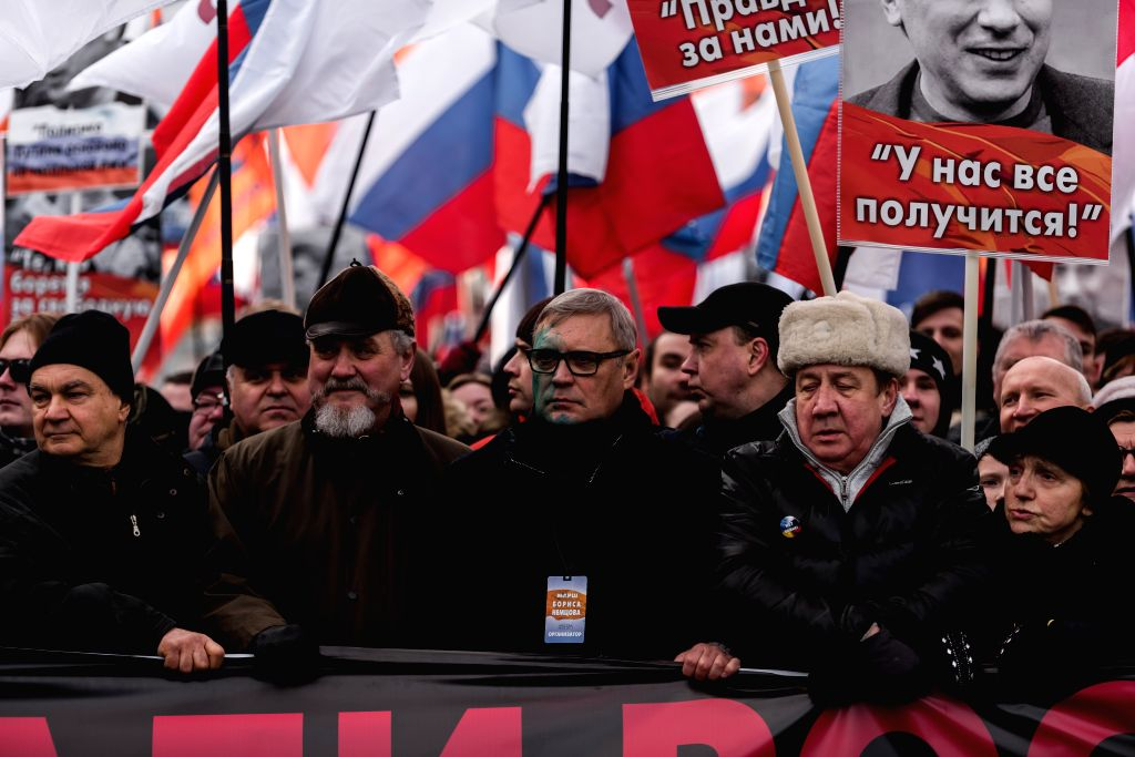 MOSCOW, Feb. 26, 2017 - Russian politician Mikhail Kasyanov(C) participates in a rally in memory of Russian politician Boris Nemtsov in Moscow, Russia, on Feb. 26, 2017. Thousands of people gathered ...