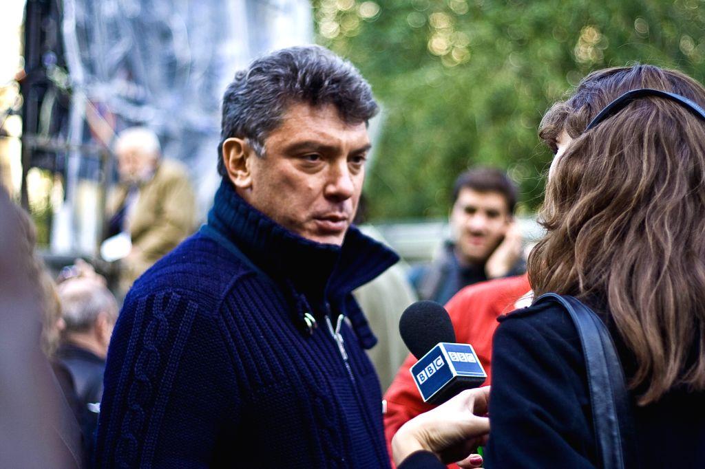 The archive photo taken on Oct. 7, 2009 shows Russian opposition leader Boris Nemtsov (L) attending a rally in memory of killed Russian journalist Anna Politkovskaya ...