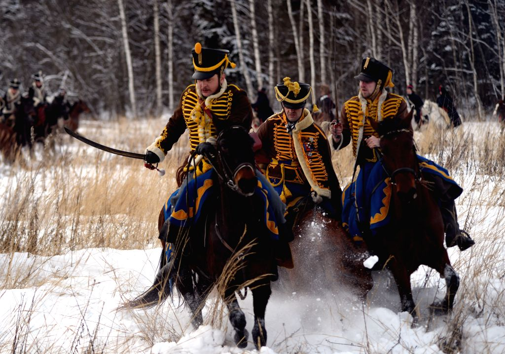 Actors perform the reenactment of the Afineyevo battle, which is part of commemorations marking the 203rd anniversary of the 1812 Russian Patriotic War, in the ...