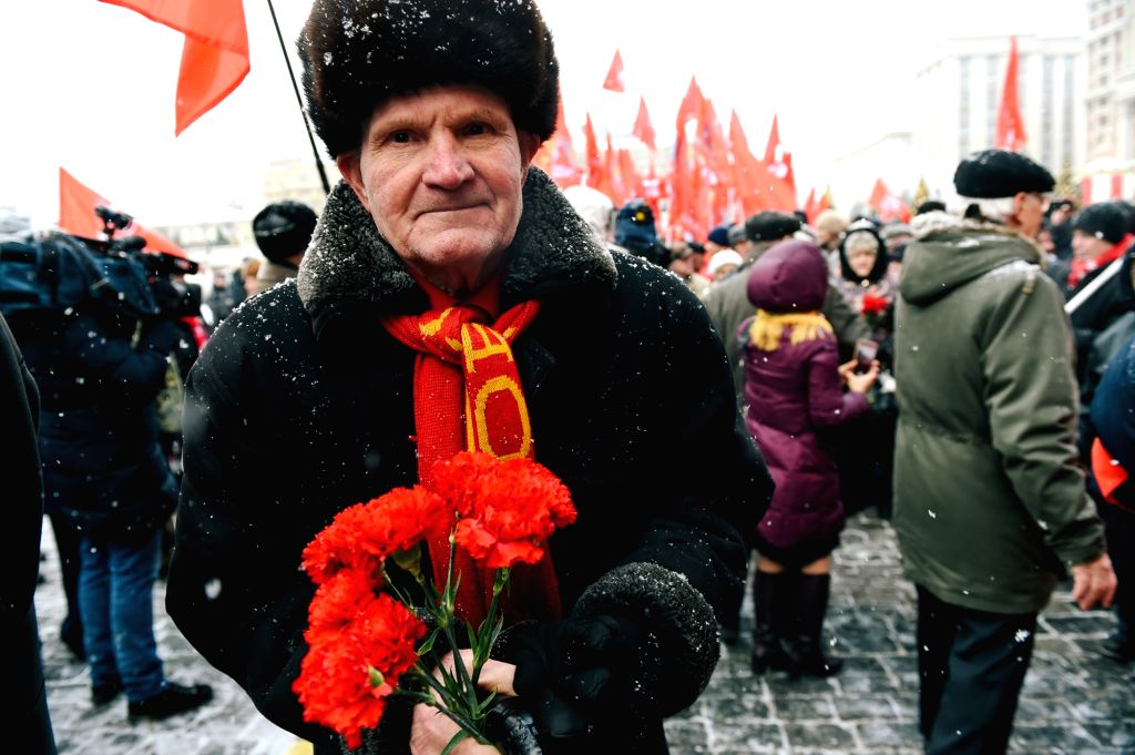 MOSCOW, Jan. 21, 2019 - A man holds flowers during the ceremony of commemorating the 95th anniversary of Vladimir Lenin's death in Moscow, Russia, on Jan. 21, 2019.