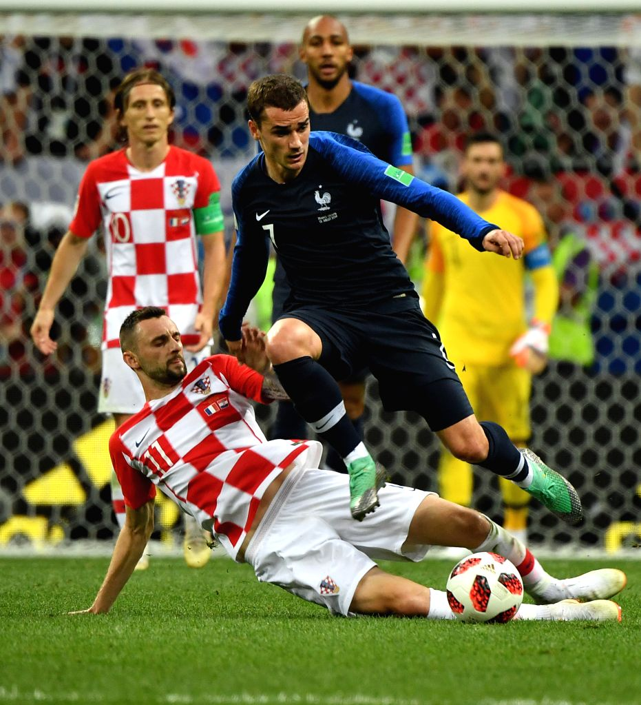 MOSCOW, July 15, 2018 - Antoine Griezmann (R front) of France vies with Marcelo Brozovic (L front) of Croatia during the 2018 FIFA World Cup final match between France and Croatia in Moscow, Russia, ...