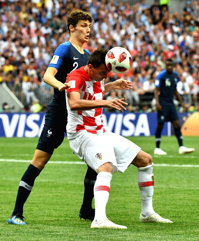 MOSCOW, July 15, 2018 - Benjamin Pavard (L) of France vies with Mario Mandzukic of Croatia during the 2018 FIFA World Cup final match between France and Croatia in Moscow, Russia, July 15, 2018.