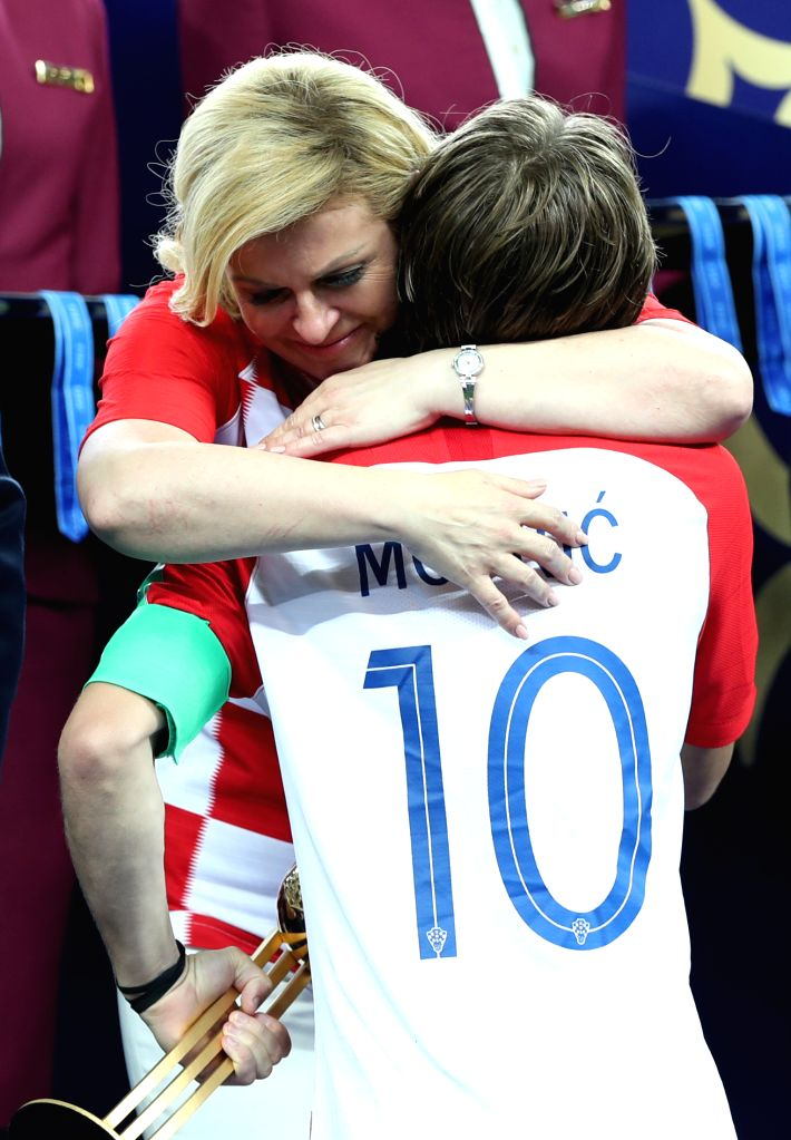 MOSCOW, July 15, 2018 - Croatian President Kolinda Grabar-Kitarovic (L) hugs Croatia's Luka Modric at the awarding ceremony after the 2018 FIFA World Cup final match between France and Croatia in ...