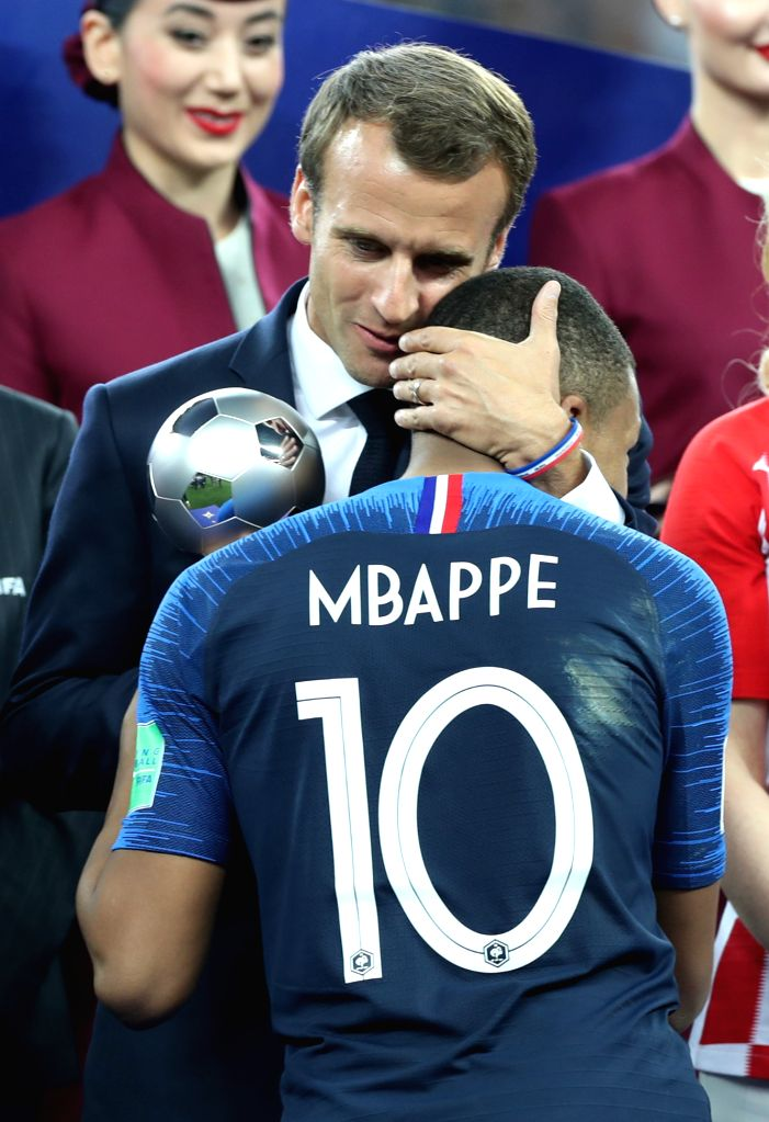 MOSCOW, July 15, 2018 - French President Emmanuel Macron hugs France's Kylian Mbappe (front) at the awarding ceremony after the 2018 FIFA World Cup final match between France and Croatia in Moscow, ...