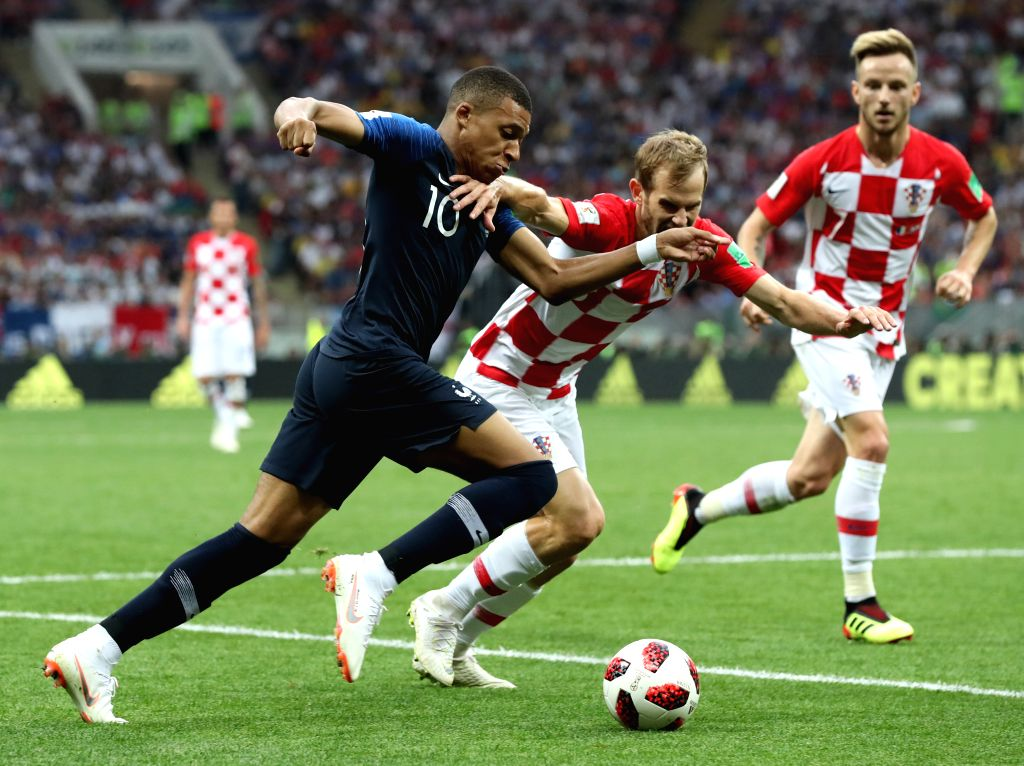 MOSCOW, July 15, 2018 - Kylian Mbappe (L) of France competes during the 2018 FIFA World Cup final match between France and Croatia in Moscow, Russia, July 15, 2018.