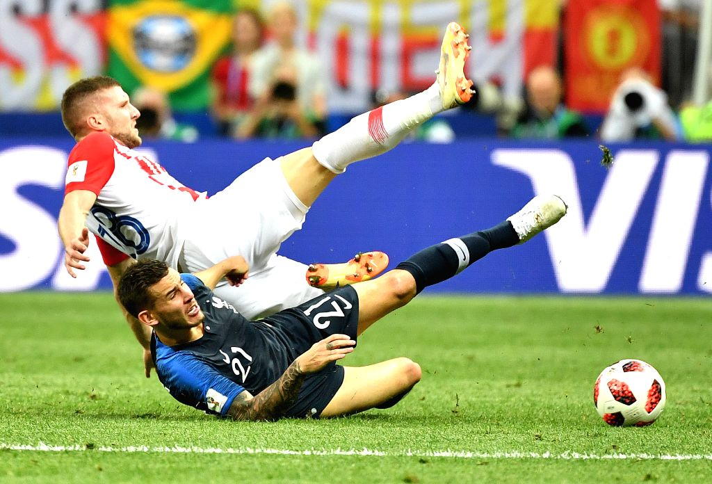 MOSCOW, July 15, 2018 - Lucas Hernandez (bottom) of France vies with Ante Rebic of Croatia during the 2018 FIFA World Cup final match between France and Croatia in Moscow, Russia, July 15, 2018.