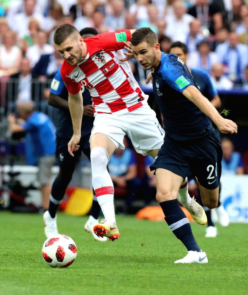 MOSCOW, July 15, 2018 - Lucas Hernandez (R) of France vies with Ante Rebic of Croatia during the 2018 FIFA World Cup final match between France and Croatia in Moscow, Russia, July 15, 2018.