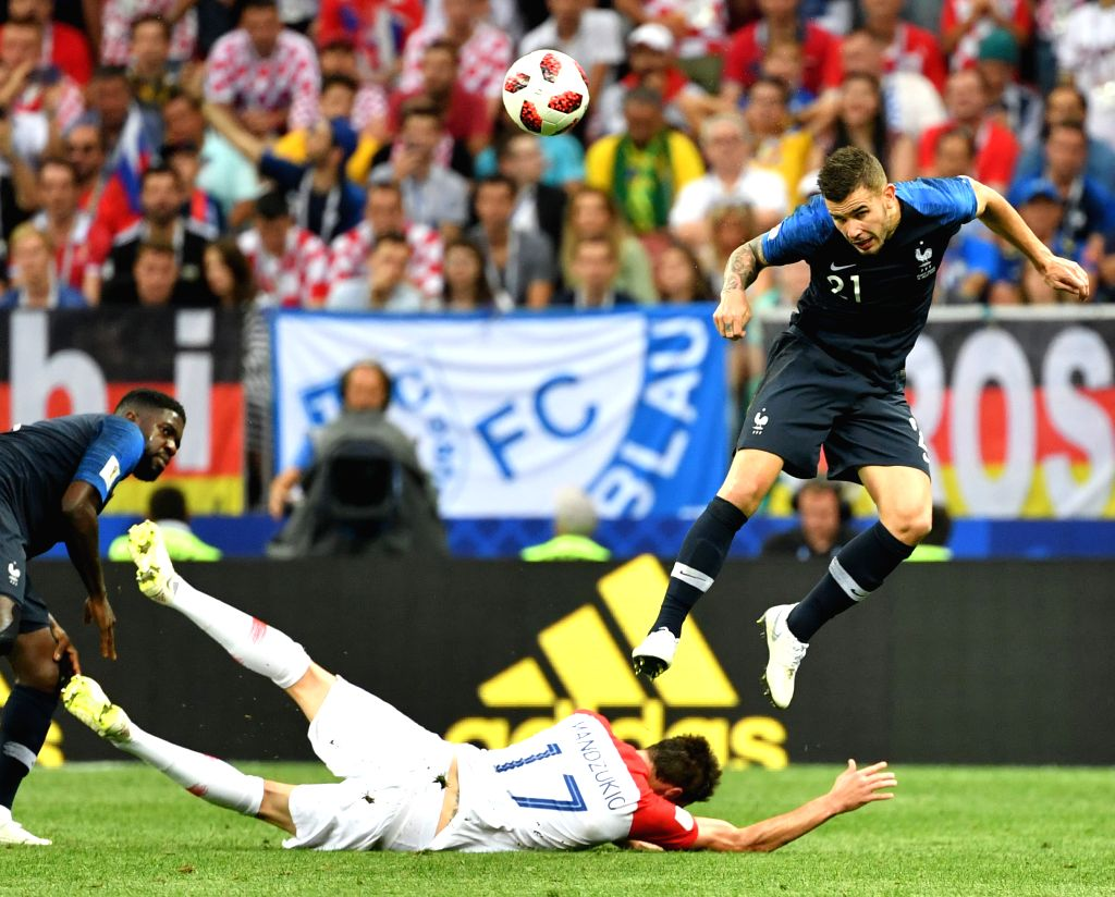 MOSCOW, July 15, 2018 - Lucas Hernandez (R) of France vies with Mario Mandzukic of Croatia during the 2018 FIFA World Cup final match between France and Croatia in Moscow, Russia, July 15, 2018.