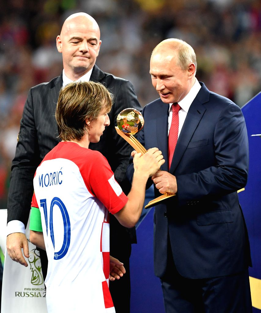 MOSCOW, July 15, 2018 - Luka Modric (L front) of Croatia receives the Golden Ball award from Russian President Vladimir Putin (R) at the awarding ceremony after the 2018 FIFA World Cup final match ...