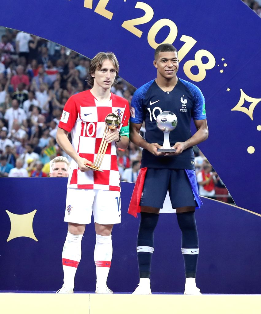 MOSCOW, July 15, 2018 - Luka Modric (L) of Croatia and Kylian Mbappe of France pose for photos at the awarding ceremony after the 2018 FIFA World Cup final match between France and Croatia in Moscow, ...