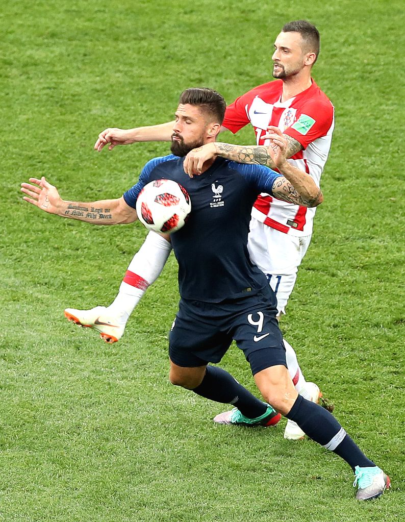MOSCOW, July 15, 2018 - Olivier Giroud (L) of France vies with Marcelo Brozovic of Croatia during the 2018 FIFA World Cup final match between France and Croatia in Moscow, Russia, July 15, 2018.
