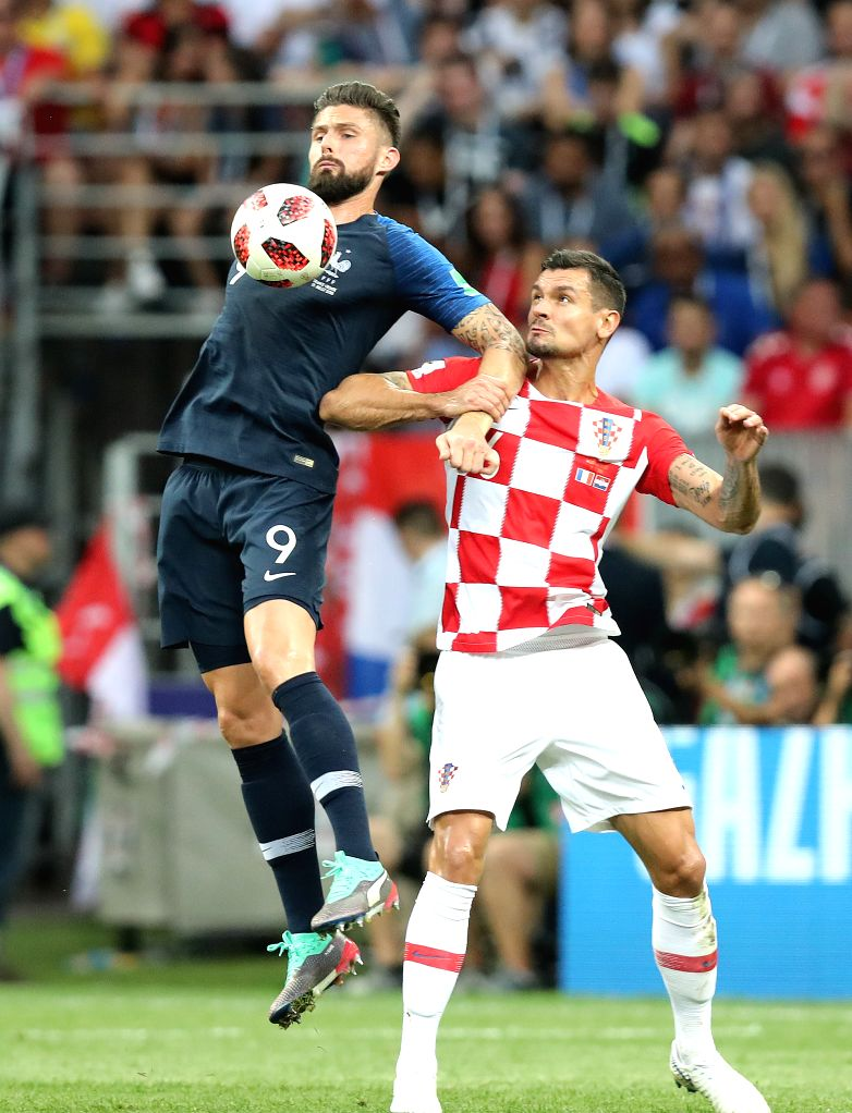 MOSCOW, July 15, 2018 - Olivier Giroud (L) of France vies with Dejan Lovren of Croatia during the 2018 FIFA World Cup final match between France and Croatia in Moscow, Russia, July 15, 2018.