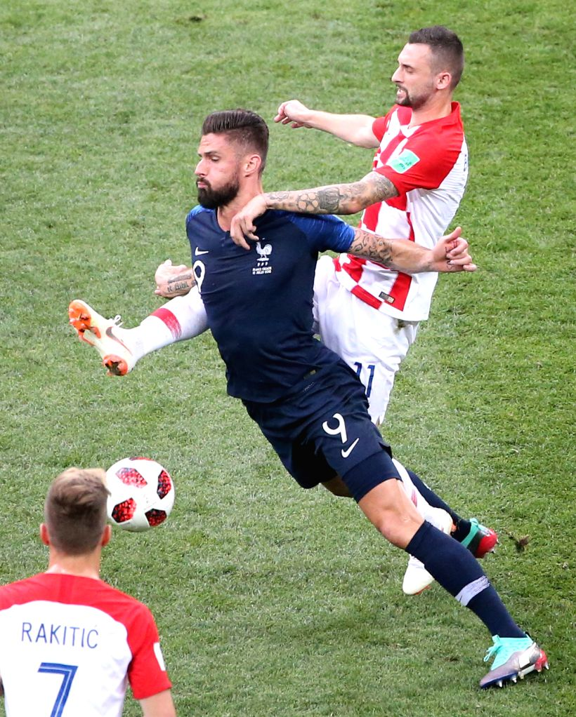 MOSCOW, July 15, 2018 - Olivier Giroud (L top) of France vies with Marcelo Brozovic (R top) of Croatia during the 2018 FIFA World Cup final match between France and Croatia in Moscow, Russia, July ...