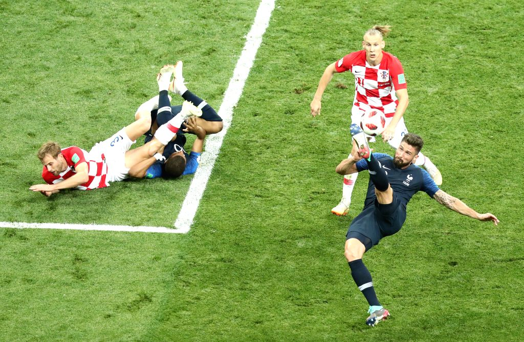 MOSCOW, July 15, 2018 - Olivier Giroud (R bottom) of France vies with Domagoj Vida (R top) of Croatia during the 2018 FIFA World Cup final match between France and Croatia in Moscow, Russia, July 15, ...