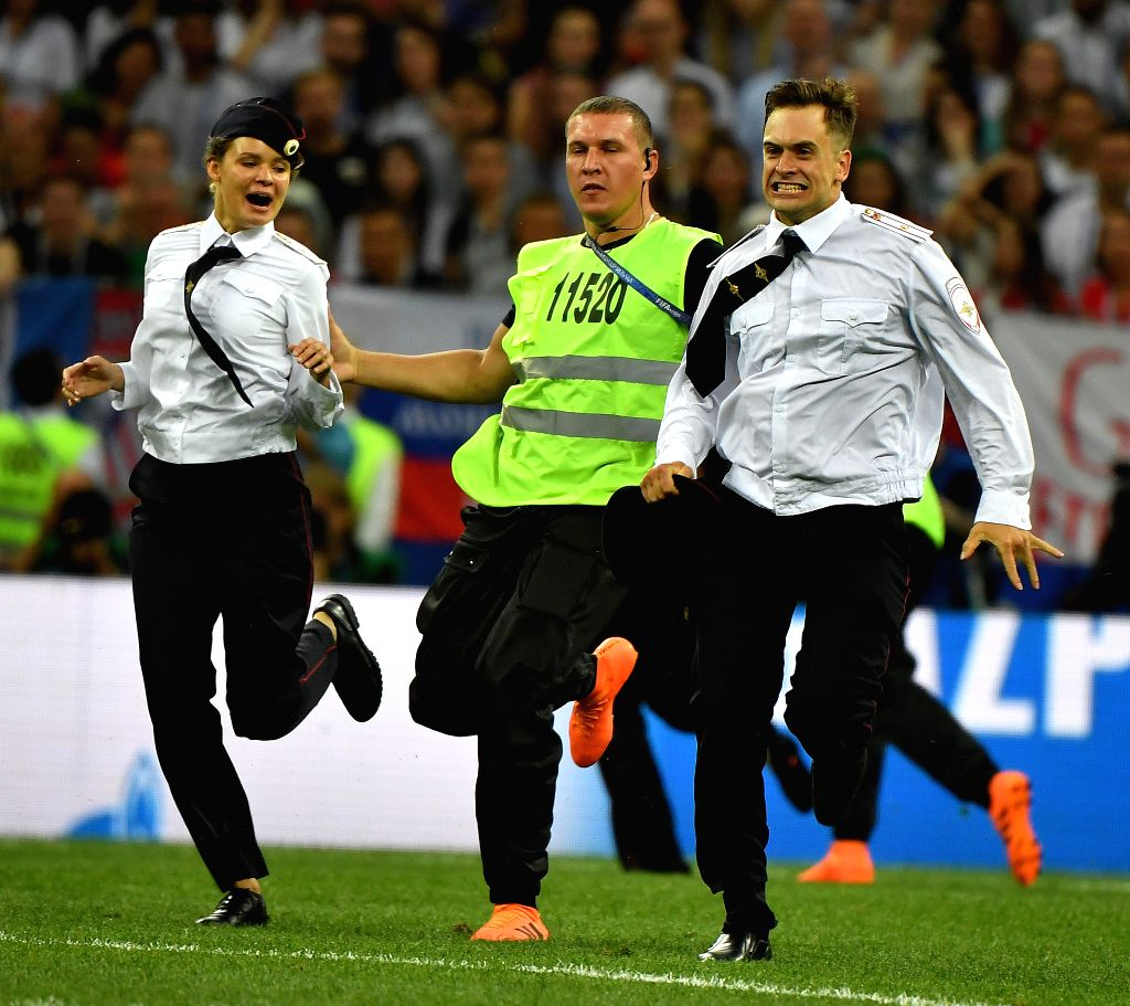 MOSCOW, July 15, 2018 - Pitch invaders are chased by stewards during the 2018 FIFA World Cup final match between France and Croatia in Moscow, Russia, July 15, 2018.