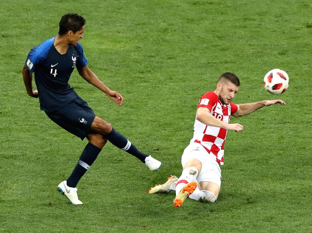 MOSCOW, July 15, 2018 - Raphael Varane (L) of France vies with Ante Rebic of Croatia during the 2018 FIFA World Cup final match between France and Croatia in Moscow, Russia, July 15, 2018.