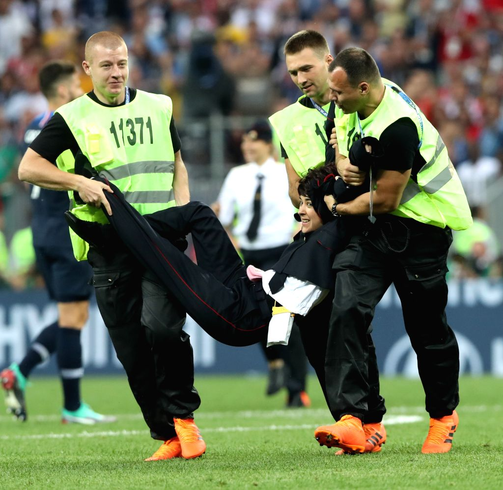 MOSCOW, July 15, 2018 - Stewards apprehend an invader during the 2018 FIFA World Cup final match between France and Croatia in Moscow, Russia, July 15, 2018.