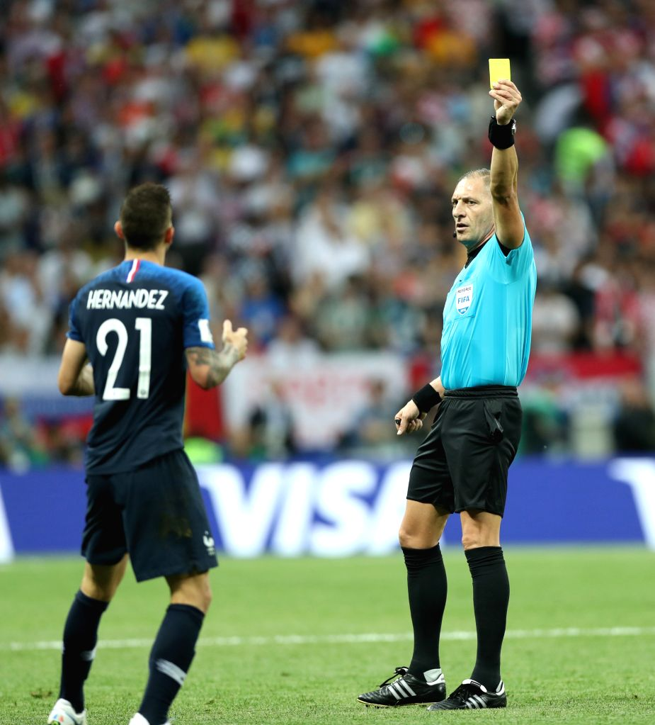 MOSCOW, July 15, 2018 - The referee gives a yellow card to Lucas Hernandez (L) of France during the 2018 FIFA World Cup final match between France and Croatia in Moscow, Russia, July 15, 2018.