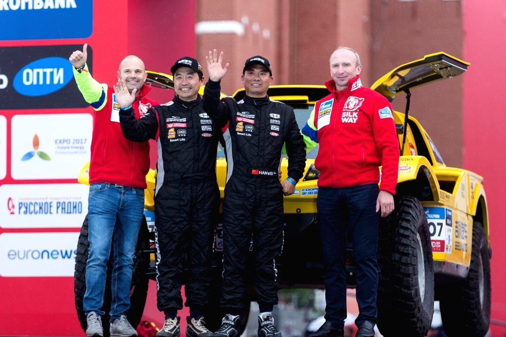 MOSCOW, July 8, 2017 - Han Wei (2nd R) and Liao Min (2nd L) of China pose during the official start of the Silk Road Rally 2017 in Moscow, Russia, on July 7, 2017.