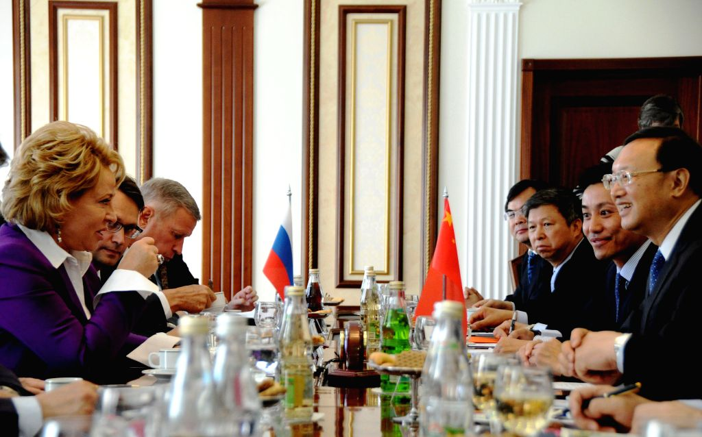(Chinese State Councilor Yang Jiechi (1st R) holds a meeting with Valentina Matviyenko (1st L), chairwoman of the Russian Federation Council, in Moscow, capital of ..