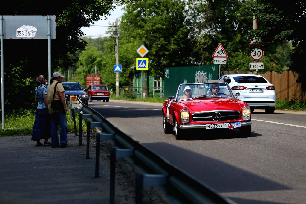 "MOSCOW, June 27, 2016 - A car is driven to the starting point during ""Bosch Moskau Klassik rally"" racing in Moscow, capital of Russia, on June 26, 2016. A classic car racing named ..."