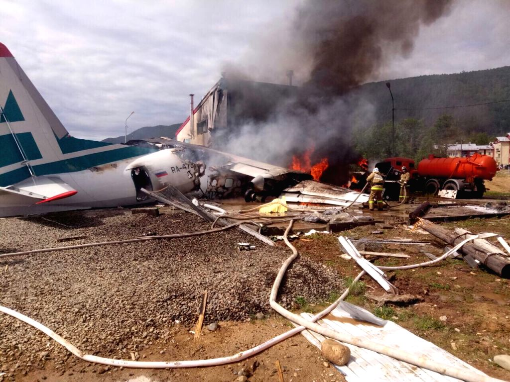 MOSCOW, June 27, 2019 (Xinhua) -- Snapshot taken from a video released by Russian Emergency Situations Ministry shows firefighters working at the site of the emergency landing at an airport in Nizhneangarsk, Russia's Republic of Buryatia, June 27, 20