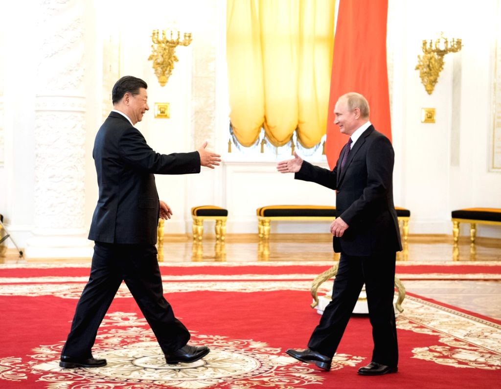 MOSCOW, June 5, 2019 - Chinese President Xi Jinping (L) shakes hands with his Russian counterpart Vladimir Putin ahead of their talks in Moscow, Russia, June 5, 2019. Xi Jinping held talks with ...