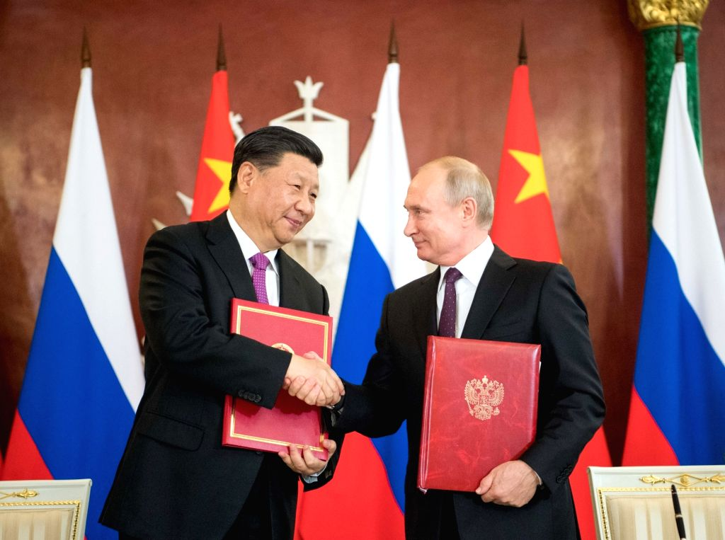 MOSCOW, June 5, 2019 - Chinese President Xi Jinping (L) and his Russian counterpart Vladimir Putin sign the statements on elevating bilateral ties to the comprehensive strategic partnership of ...