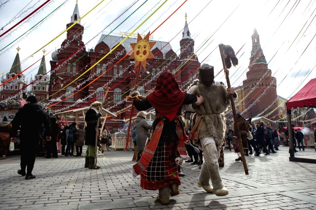 MOSCOW, March 1, 2019 - People dressed in traditional costumes dance during the Maslenitsa celebration in central Moscow, Russia, on March 1, 2019. Maslenitsa is a traditional Russian holiday to ...