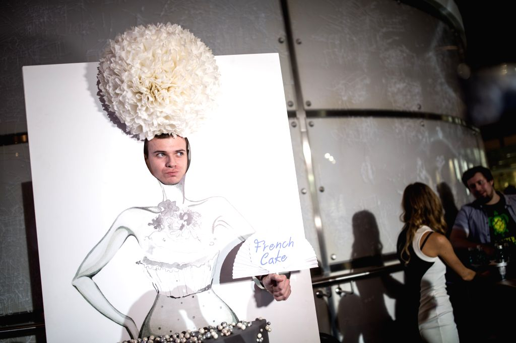 MOSCOW, March 13, 2017 - A man poses for photos at the Mercedes-Benz Fashion Week in Moscow, Russia, March 12, 2017. The 6-day Mercedes-Benz Fashion Week opened Sunday in Moscow.