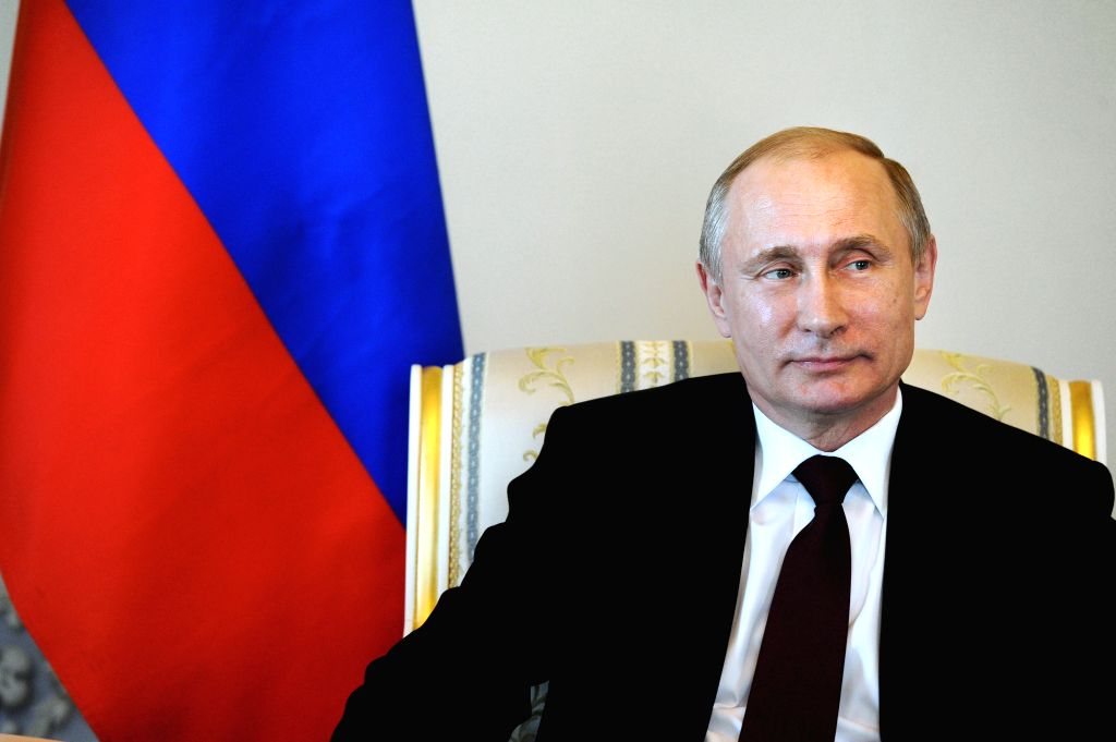 Russian President Vladimir Putin meets with his visiting Kyrgyz counterpart Alazbek Atambayev in St. Petersburg, Russia, on March 16, 2015. It was the Russian ...