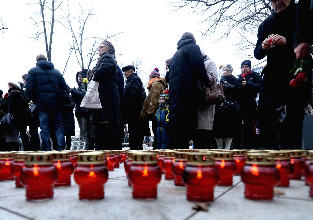 People attend a memorial service for murdered Russian opposition leader Boris Nemtsov held in Moscow, on March 3, 2015.