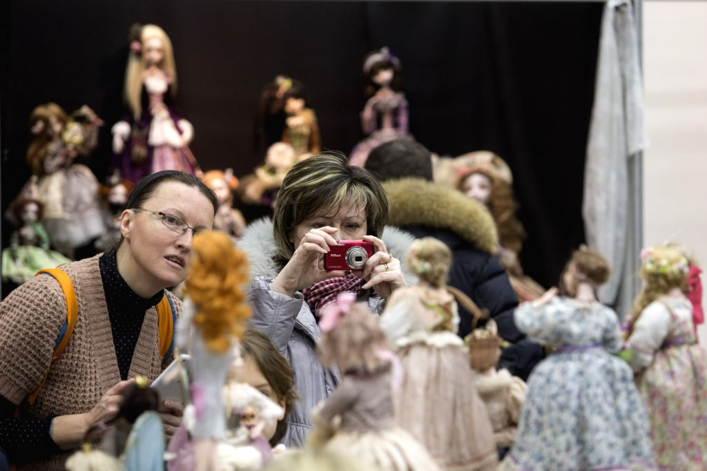MOSCOW, March 5, 2017 - Visitors take pictures of dolls on display at a doll exposition in Moscow, Russia, March 5, 2017.