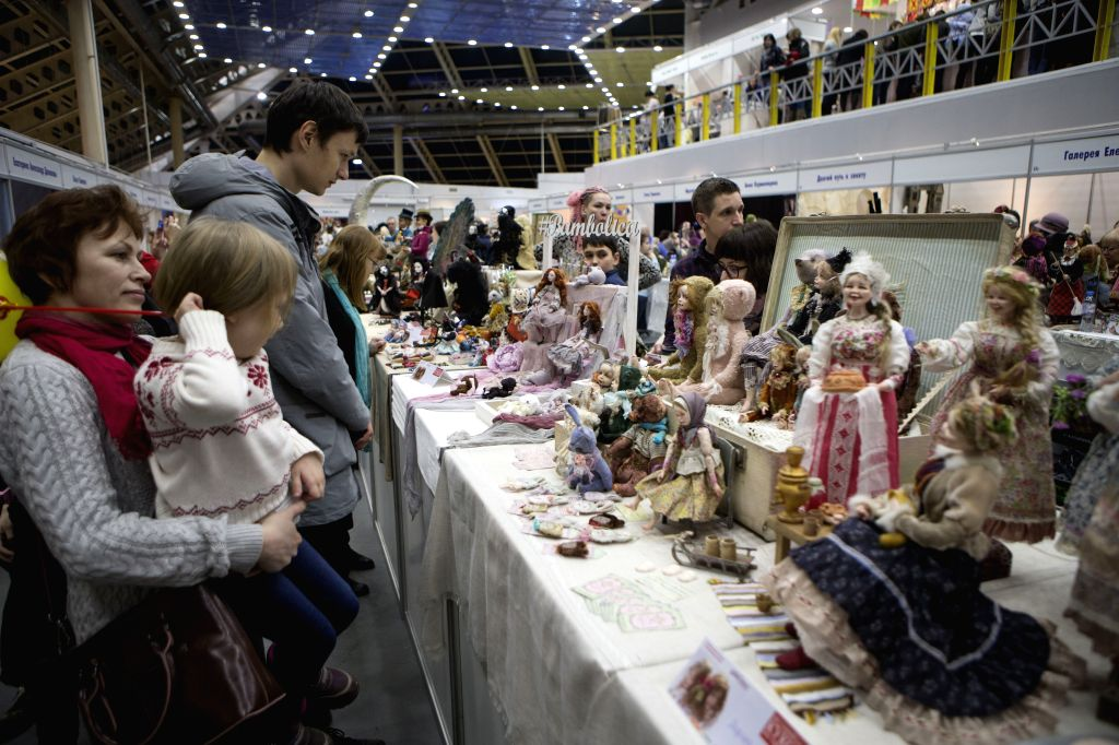 MOSCOW, March 5, 2017 - Visitors view dolls on display at a doll exposition in Moscow, Russia, March 5, 2017.