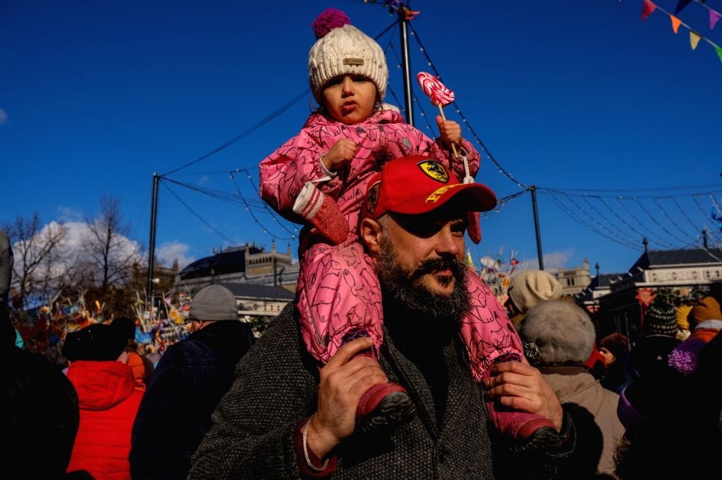 MOSCOW, March 9, 2019 - A man carrying a girl on his shoulders walks on Manezhnaya square during the Maslenitsa celebration in Moscow, Russia, on March 9, 2019. Maslenitsa is a traditional Russian ...