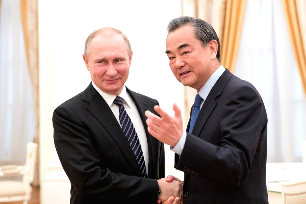 MOSCOW, May 25, 2017 - Russian President Vladimir Putin (L) meets with visiting Chinese Foreign Minister Wang Yi in the Kremlin, Moscow, Russia on May 25, 2017. - Wang Y