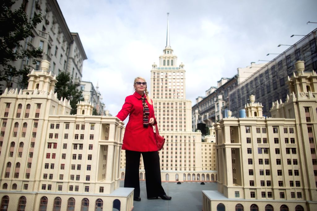 MOSCOW, Sept. 10, 2017 - A woman poses for a photo by the model of Moscow buildings in Tverskaya street during the 870th anniversary of Moscow in Moscow, Russia, Sept. 9, 2017.
