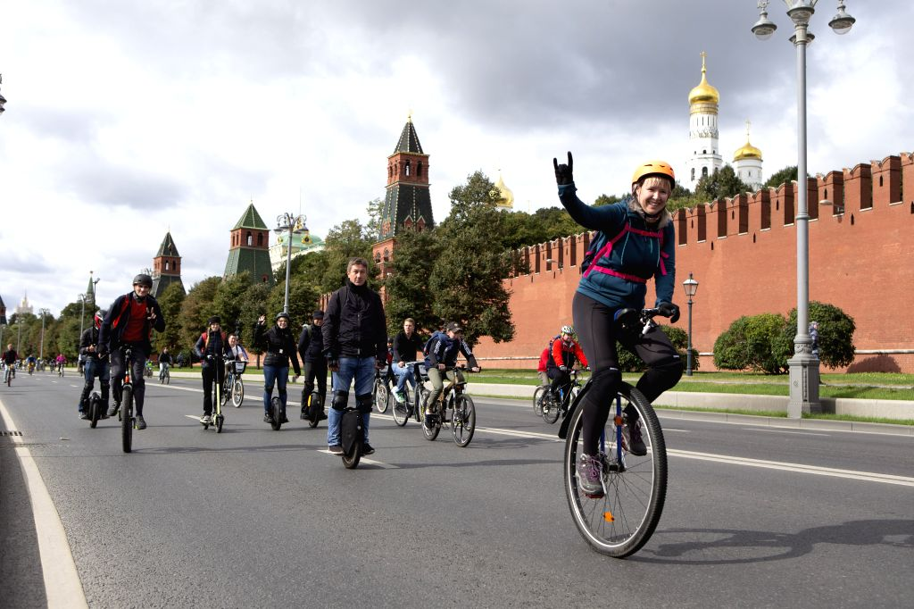 MOSCOW, Sept. 15, 2019 - People ride bicycles in front of Kremlin during the Moscow Autumn Cycling Festival in central Moscow, Russia, on Sept. 15, 2019. About 30,000 cyclists flocked to Moscow ...