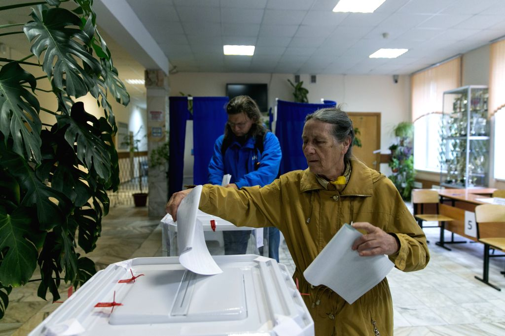 MOSCOW, Sept. 18, 2016 - People vote at a polling station in Moscow, capital of Russia, on Sept. 18, 2016. The election of the 7th State Duma of Russia started on early Sunday, the Russian news ...