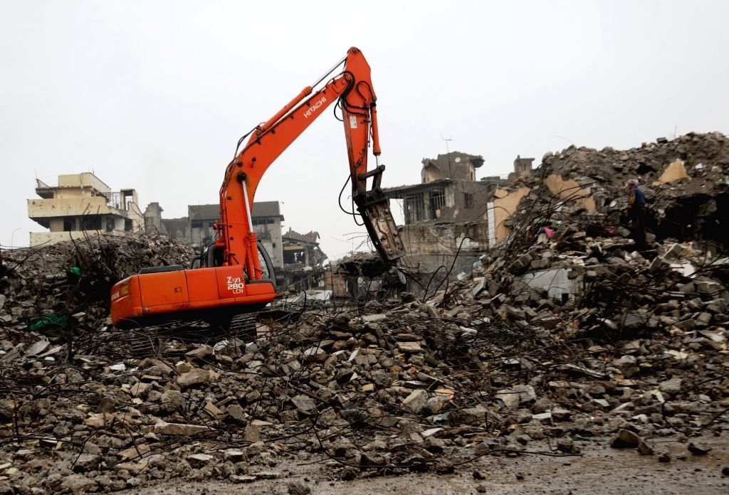 MOSUL (IRAQ), Dec. 5, 2018 An excavator works on the debris in the old city of Mosul, Iraq, on Dec. 5, 2018. About 17 months after liberation from the extremist Islamic State (IS) ...