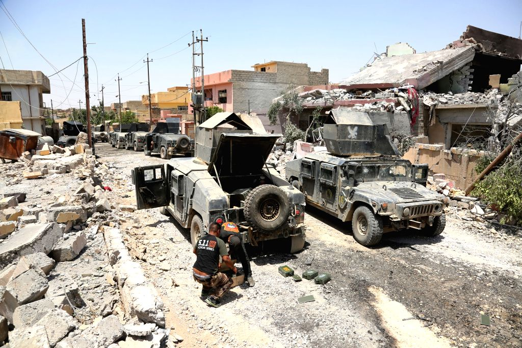 MOSUL (IRAQ), May 29, 2017 Two Iraqi soldiers check ammunition in al-Saha neighborhood of western Mosul, Iraq on May 29, 2017. Iraqi Prime Minister Haider al-Abadi said on Monday that ... - Haider