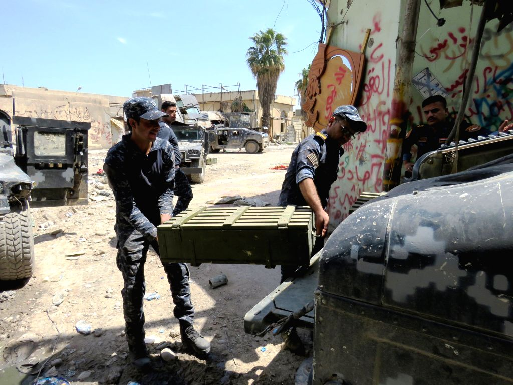 MOSUL (IRAQ), May 7, 2017 Members of Iraqi Federal Police carry ammunition in south of the Old City in western Mosul, Iraq, on May 7, 2017. A group of Iraqi Federal Police members fought ...